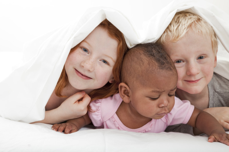 young children playing under the covers